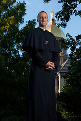 Rev. Dan Parrish, C.S.C. on the campus of the University of Notre Dame...Photo by Matt Cashore..Use of this image prohibited without authorization and/or compensation..To contact Matt Cashore:.574.220.7288.574.233.6124.cashore1@michiana.org.www.mattcashore.com