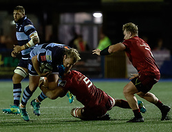 Kristian Dacey of Cardiff Blues is tackled by Tadhg Beirne of Munster<br /> <br /> Photographer Simon King/Replay Images<br /> <br /> Guinness PRO14 Round 4 - Cardiff Blues v Munster - Friday 21st September 2018 - Cardiff Arms Park - Cardiff<br /> <br /> World Copyright © Replay Images . All rights reserved. info@replayimages.co.uk - http://replayimages.co.uk