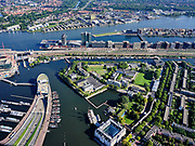 Nederland, Noord-Holland, Gemeente Amsterdam; 02-09-2020; Zicht op het Oosterdok en deel Kattenburg met Marineterrein (Marine Etablissement Amsterdam) en Scheepvaartmuseum. In het water van het Oosterdok de ingang van IJtunnel, met  Nemo Science Museum. Op ODE- Oosterdokseiland, de nieuwbouw Booking.com. <br /> Eastern Dock with new hotspot former Navy yard. Tunnel entrance with Nemo Science Museum, Central Station.<br /> <br /> luchtfoto (toeslag op standaard tarieven);<br /> aerial photo (additional fee required)<br /> copyright © 2020 foto/photo Siebe Swart<br /> copyright © 2020 foto/photo Siebe Swart