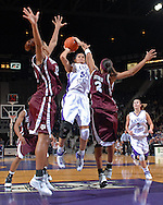 Kansas State forward Marlies Gipson (C) puts up a shot over Texas A&M's Morenike Atunrase (L) and Takia Starks (R) in the second half at Bramlage Coliseum in Manhattan, Kansas, January 6, 2007.  K-State upset 17th ranked Texas A&M 48-45.