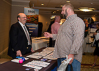 Rick Hopper WEMJ speaks with Isaac Brake of Creative Impact at the Lakes Region Business Resource Fair at the Margate Wednesday morning.  (Karen Bobotas/for the Laconia Daily Sun)