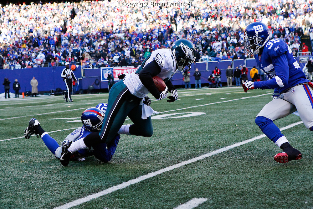 11 Jan 2009: Philadelphia Eagles safety Quintin Demps #39 i tackled by New York Giants safety Kenny Phillips #21 during the game against the New York Giants on January 11th, 2009.  The  Eagles won 23-11 at Giants Stadium in East Rutherford, New Jersey.