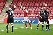 Cheltenham Town forward Andy Williams (14) celebrates his side's opening goal during the EFL Sky Bet League 2 match between Cheltenham Town and Crawley Town at Jonny Rocks Stadium, Cheltenham, England on 10 October 2020.