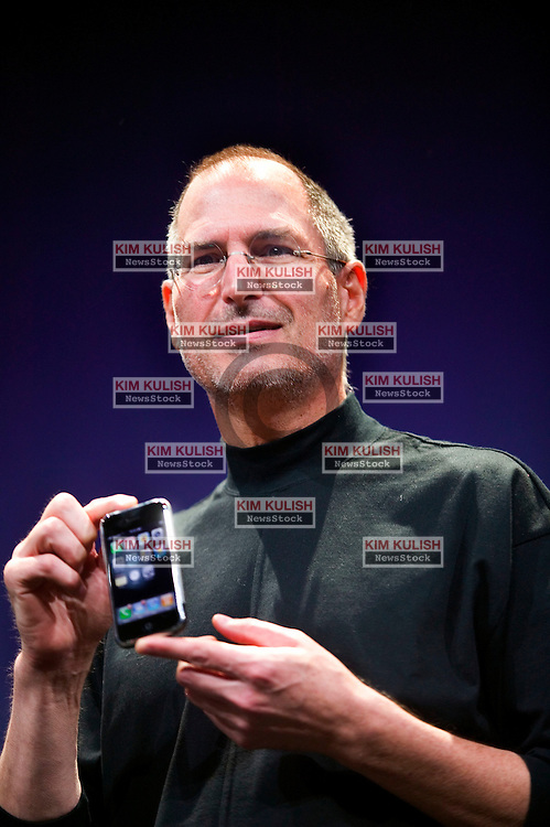 """Apple chief executive Steve Jobs unveils the """"iPhone,"""" a new mobile phone that can also be used as a digital music player and a camera at the Macworld Conference in San Francisco, California.  Photo by Kim Kulish"""