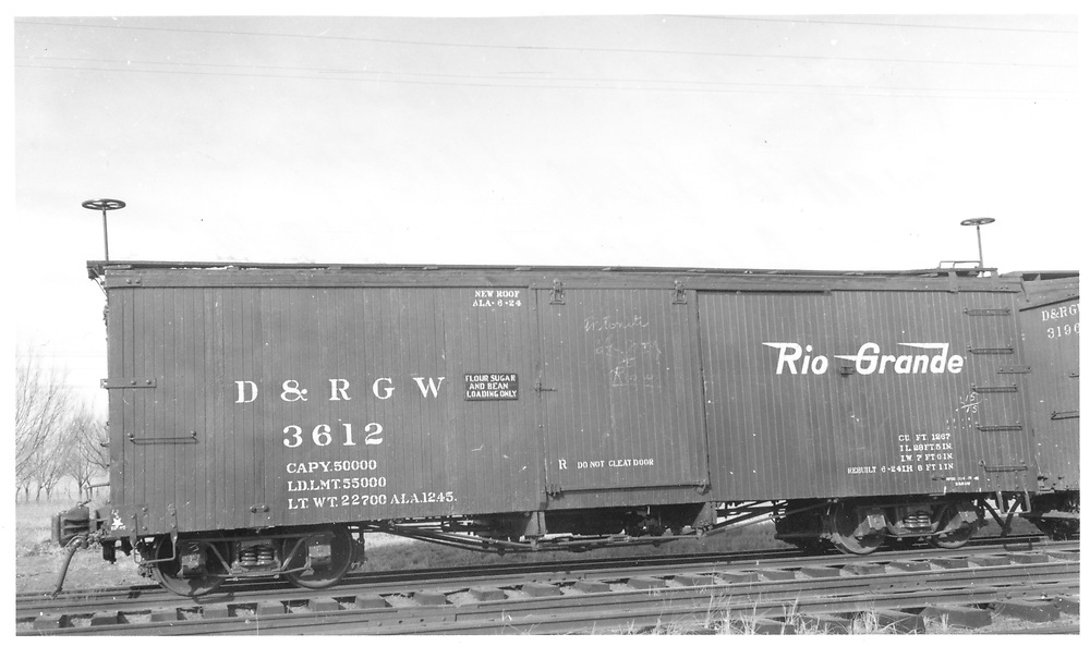 """Side view of box car #3612 at Alamosa.  Stencilled """"Flour Sugar and Bean Loading Only"""".<br /> D&RGW  Alamosa, CO  Taken by Maxwell, John W. - 1/18/1946"""