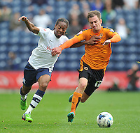 Preston North End's Daniel Johnson battles with Wolverhampton Wanderers' Jed Wallace<br /> <br /> Photographer Dave Howarth/CameraSport<br /> <br /> Football - The Football League Sky Bet Championship - Preston North End v Wolverhampton Wanderers - Saturday 26th September 2015 - Deepdale - Preston<br /> <br /> © CameraSport - 43 Linden Ave. Countesthorpe. Leicester. England. LE8 5PG - Tel: +44 (0) 116 277 4147 - admin@camerasport.com - www.camerasport.com