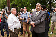 North Charleston Mayor Keith Summey and Police Chief Eddie Driggers wait for a peace vigil to begin on the spot where unarmed motorist Walter Scott was gunned down by police April 12, 2015 in North Charleston, South Carolina. About 100 people showed up for the brief vigil following a healing service at Charity Mission Baptist Church.