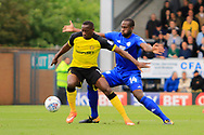 Burton Albion striker Lucas Akins (10) and Cardiff City defender Souleymane Bamba (14) during the EFL Sky Bet Championship match between Burton Albion and Cardiff City at the Pirelli Stadium, Burton upon Trent, England on 5 August 2017. Photo by Richard Holmes.
