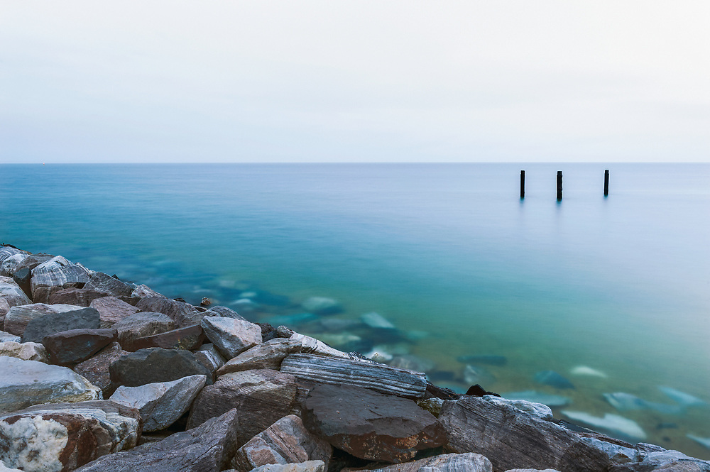A long exposure turns the churning waters where the Potomac River and Chesapeake Bay meet seemingly to glass at the tip of Point Lookout State Park in St. Mary's County, MD.