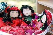 Asian dolls in kimono outfits sitting in basket at concession stand. Dragon Festival Lake Phalen Park St Paul Minnesota USA