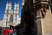 Tourists gather at Westminter Abbey, London. This is one of tha main tourism areas of the city and is both working church as well as tourist destination.