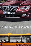 Riesige Werbung an einem Plattenbau fuer den neuen Skoda Superb in der Naehe der Skoda Autowerke im Zentrum von Mlada Boleslav. Mlada Boleslav liegt noerdlich von Prag und ist ungefaehr 60 Kilometer von der tschechischen Haupstadt entfernt. Skoda Auto beschäftigt in Tschechien 23.976 Mitarbeiter (Stand 2006), den Grossteil davon in der Zentrale in Mlada Boleslav. Damit sind mehr als 3/4 aller Erwerbstätigen der Stadt in dem Automobilkonzern tätig. <br /> <br />                                      Bigboard commercial at a panel house close to the Skoda factory in the city of Mlada Boleslav. The city is located north of Prague and about 60 km away from the Czech capital. Skoda Auto has about 23.976 employees (2006) in Czech Republic and a big part of them is working in Mlada Boleslav. 3/4 of the working population in Mlada Boleslav is working for the Skoda Auto company.