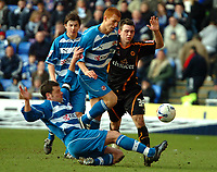 Photo: Ed Godden.<br />Reading v Wolverhampton Wanderers. Coca Cola Championship. 18/03/2006. <br />Reading players, Graeme Murty (L) and Steve Sidwell (C) clash in an attept to clear the ball.