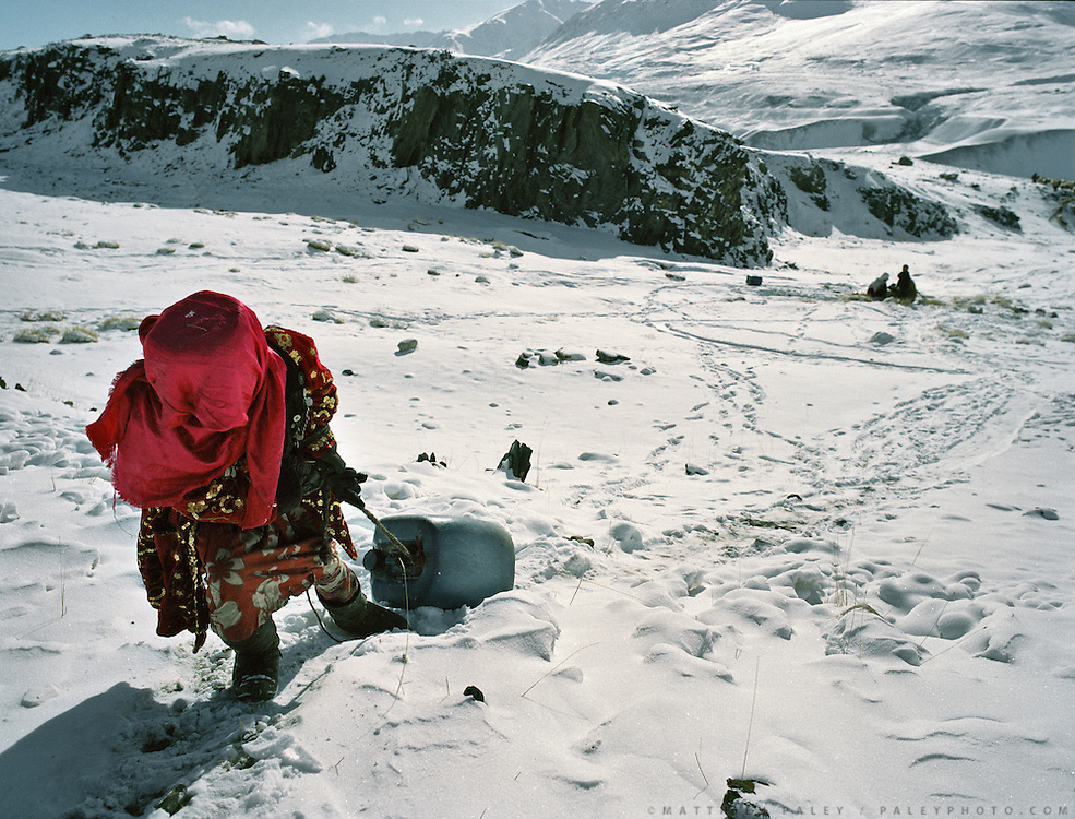 Bibi Hawa pulling water container up the slope back to her house..Sultan's family is getting water in the morning..Campment of Tshar Tash (Haji Osman's camp), in the Wakhjir valley, at the source of the Oxus..Winter expedition through the Wakhan Corridor and into the Afghan Pamir mountains, to document the life of the Afghan Kyrgyz tribe. January/February 2008. Afghanistan