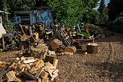 Sipson, UK. 5th June, 2018. A space for cutting wood is pictured at Grow Heathrow. Grow Heathrow is a squatted off-grid eco-community garden founded in 2010 on a previously derelict site close to Heathrow airport to rally support against government plans for a third runway and it has since made a significant educational and spiritual contribution to life in the Heathrow villages, which remain threatened by Heathrow airport expansion.