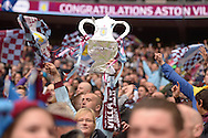 Aston Villa fan holding up a cardboard FA Cup Trophy as he celebrates after the final whistle as they book their place in the FA Cup Final.The FA Cup, semi final match, Aston Villa v Liverpool at Wembley Stadium in London on Sunday 19th April 2015.<br /> pic by John Patrick Fletcher, Andrew Orchard sports photography.
