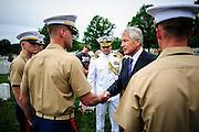 Secretary of Defense Chuck Hagel greets Marines during a Memorial Day visit to Arlington National Cemetery in Arlington Virginia, USA on 27 May, 2013.