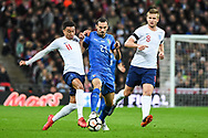 England Midfielder Jesse Lingard (11) and Italy Defender Davide Zappacosta (21) battle for the ball during the Friendly match between England and Italy at Wembley Stadium, London, England on 27 March 2018. Picture by Stephen Wright.
