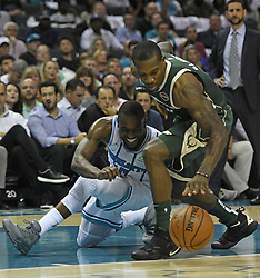October 17, 2018 - Charlotte, NC, USA - The Charlotte Hornets' Kemba Walker (15) tries to gain control of the ball from the Milwaukee Bucks' Eric Bledsoe (6) in the second half at the Spectrum Center in Charlotte, N.C., on Wednesday, Oct. 17, 2018. The Bucks won, 113-112. (Credit Image: © David T. Foster Iii/Charlotte Observer/TNS via ZUMA Wire)