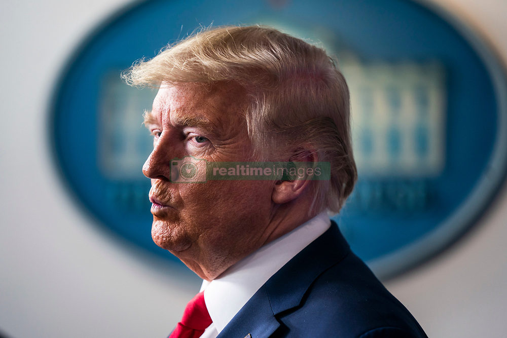 March 22, 2020, Washington, District of Columbia, USA: US President DONALD J TRUMP reacts after delivering remarks on the pandemic in the press briefing room of the White House. Efforts to contain the coronavirus COVID-19 pandemic have caused travel disruptions, sporting event cancellations, runs on cleaning supplies and food and other inconveniences  (Credit Image: © Jim Loscalzo/CNP via ZUMA Wire)