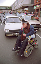 Man; who is wheelchair user; protesting about access to public transport,
