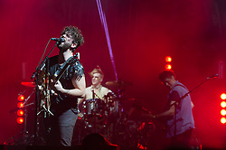 © Licensed to London News Pictures. 06/09/2014. Isle of Wight, UK. Foals performing live at Bestival 2014 Day 3 Saturday. In this picture Yannis Philippakis (left), Jack Bevan (centre), Walter Gervers (right).   Foals are an English indie rock band from consisting of members Yannis Philippakis (lead vocals, lead guitar,drums), Jack Bevan (drums), Jimmy Smith (rhythm guitar), Walter Gervers (bass), Edwin Congreave (keyboards).  This weekend's headliners include Chic featuring Nile Rodgers, Foals and Outcast.   Bestival is a four-day music festival held at the Robin Hill country park on the Isle of Wight, England. It has been held annually in late summer since 2004.    Photo credit : Richard Isaac/LNP