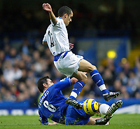 12/5/2004 - Chelsea v  Everton , Stamford Bridge - FA Barclays Premiership.<br />Chelsea's Frank Lampard slide underneath Everton's Leon Osman to win the ball<br />Photo:Jed Leicester/Back Page Images