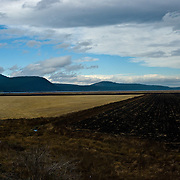 Farming is a key activity in the Klamath Basin in soutern Oregon.  The eastern side of the Cascade Mountains are visible in the distance.