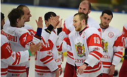 Cape Town 180420 Giorgia player of the tournament Zhuzhunashvili Aleksandr greets his teammates as he moves forwrd to collect his award in a Ice Hokey world championship against CHINA Taipei Grand West Casino.photograph:Phando Jikelo/African News Agency/ANA