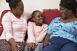 Three generations of women at home together,