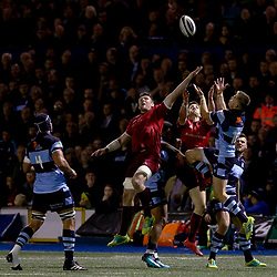 Gareth Anscombe of Cardiff Blues vies with Peter O'Mahony of Munster for the high ball<br /> <br /> Photographer Simon King/Replay Images<br /> <br /> Guinness PRO14 Round 4 - Cardiff Blues v Munster - Friday 21st September 2018 - Cardiff Arms Park - Cardiff<br /> <br /> World Copyright © Replay Images . All rights reserved. info@replayimages.co.uk - http://replayimages.co.uk