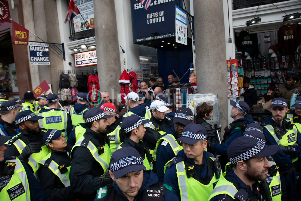 Demonstrators on the opposing side of the arguement are hemmed in my riot police then escorted away for their own protection at the 'Oppose Tommy Robinson, unite against racism & fascism' counter demonstration organised for anti-fascist groups opposed to far right politics, regardless of their positions on leave/remain on Brexit on 9th December 2018 in London, United Kingdom.