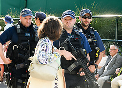 July 3, 2017 - London, London, UK - Licensed to London News Pictures. .The Championship Wimbledon 2017 Wimbledon, UK. .CAPTION:   Armed police patrol the tennis crowds at this year's championships. (Credit Image: © Peter Van Den Berg/London News Pictures via ZUMA Wire)