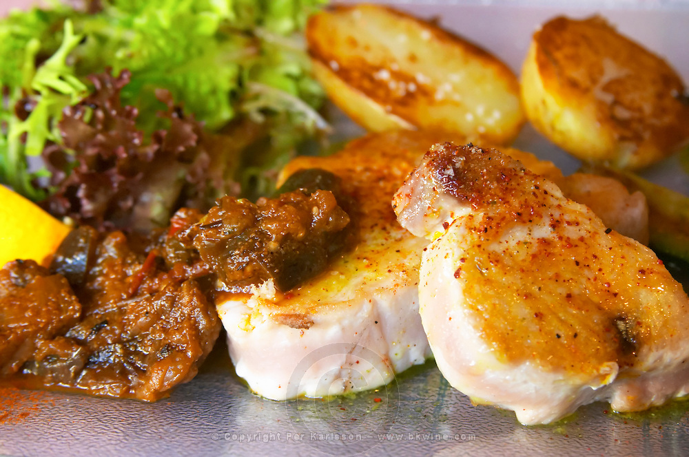 Gruissan village. La Clape. Languedoc. Restaurant La Cranquette. Tuna fish with potatoes and salad. France. Europe.