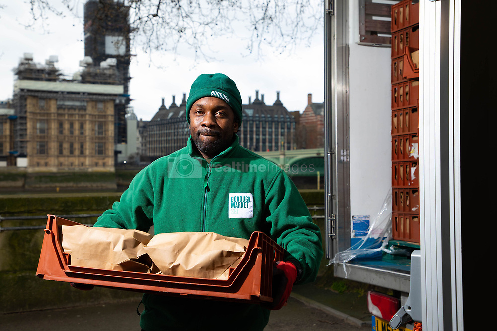 EDITORIAL USE ONLY Volunteers help unload some of a thousand fruit and vegetable packages outside St Thomas' Hospital, which are destined for healthcare workers fighting the COVID-19 pandemic as Borough Market spearheads the national 'Feed The Frontline' campaign, London.