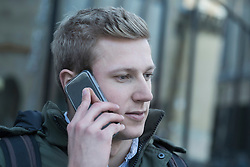 College student talking on a mobile phone, Freiburg im Breisgau, Baden-Wuerttemberg, Germany