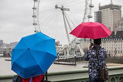 © Licensed to London News Pictures. 07/12/2017. London, UK. People brave strong winds and heavy rain in central London as Storm Caroline approaches Britain. Photo credit: Rob Pinney/LNP