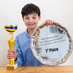 Reuben poses with his trophies. Brothers Reuben and Josh Moisey are top level Scrabble Champions with 11 year-old Reuben crowned European Youth Scrabble Champion and 8 year-old Josh became World Under Eight Scrabble Champion in Dubai in 2018. London, August 15 2019.