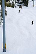 Chair Lift. People skiing and preparing to ski at Keystone Ski Resort, Keystone, Colorado, USA.