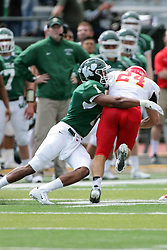 19 September 2015:  Ben Bouie wraps up Jordan Beem during an NCAA division 3 football game between the Simpson College Storm and the Illinois Wesleyan Titans in Tucci Stadium on Wilder Field, Bloomington IL