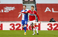Blackburn Rovers defender Barry Douglas (15) and Middlesbrough midfielder Marcus Tavernier (7)  during the EFL Sky Bet Championship match between Middlesbrough and Blackburn Rovers at the Riverside Stadium, Middlesbrough, England on 24 January 2021.