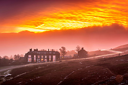 © Licensed to London News Pictures. 24/01/2019. Ilkley UK. The Cow & Calf pub on Ilkley Moor is shrouded in a red glow at dawn this morning in Yorkshire. Photo credit: Andrew McCaren/LNP