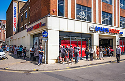 © Licensed to London News Pictures. 15/06/2020. London, UK. Shoppers queue at Sorts Direct in Kingston, South West London as non essential shops are given the green light to open in England after 3 months of being closed due to the coronavirus pandemic. Also commuters are told to wear face masks from Monday while travelling on Public transport. Photo credit: Alex Lentati/LNP