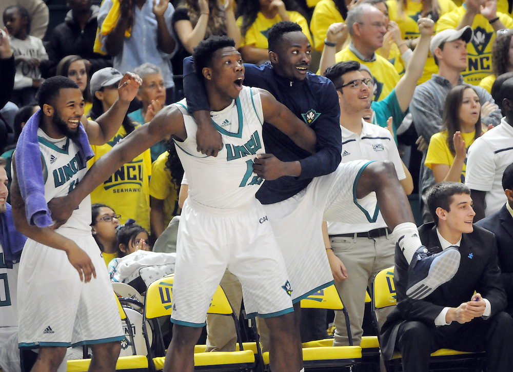 From left, UNCW's Jordon Talley, Devontae Cacok and Chuck Ogbodo react in the final minute of the game against James Madison at Trask Coliseum on Saturday. Mike Spencer/StarNews