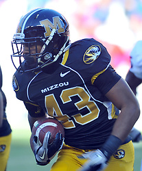 Nov 27, 2010; Kansas City, MO, USA; Missouri Tigers running back Marcus Murphy (43) runs for yardage in the second half of the game against the Kansas Jayhawks at Arrowhead Stadium. Missouri won 35-7. Mandatory Credit: Denny Medley-US PRESSWIRE