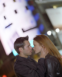 couple looking at one another at night in New York City