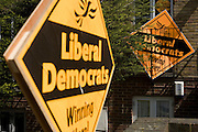 Liberal Democrat (Lib Dem) supporters display their political party sign outside their Dulwich house before Britain's general election. The large orange signs are prominently displayed outside the south London home in Southwark, urging other voters to support what was until the start of this campaign, the third political party under Nick Clegg.