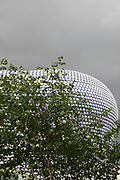 Modern landmark architecture of the Selfridges Building in Birmingham, United Kingdom. The building is part of the Bullring Shopping Centre and houses Selfridges Department Store. The building was completed in 2003 at a cost of £60 million and designed by architecture firm Future Systems. It has a steel framework with sprayed concrete facade. Since its construction, the building has become an iconic architectural landmark and seen as a major contribution to the regeneration of Birmingham.