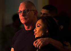 December 21, 2017 - Sevilla, Spain - Chef Robert Irvine and his wife wrestler Gail Kim watch country music artist Jerrod Niemann perform during Chairmans USO Holiday Tour at Moon Air Base Dec. 21, 2017. Marine Corps Gen. Joe Dunford, chairman of the Joint Chiefs of Staff, and Army Command Sgt. Maj. John W. Troxell, senior enlisted advisor to the chairman, along with USO entertainers, visited service members who are deployed during the holidays at various locations across Europe and the Middle East. .(Credit Image: