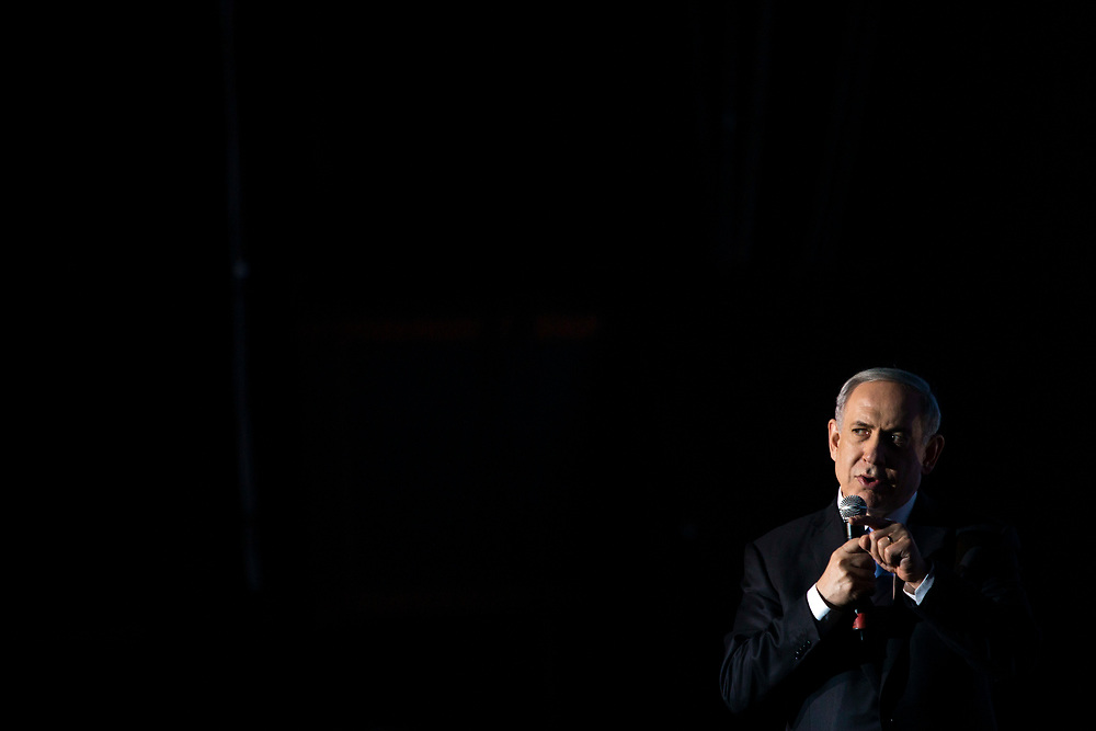 Israel's Prime Minister Benjamin Netanyahu waves for the crowd during a Taglit-Birthright Israel event in Jerusalem, Israel, on January 14, 2015. Taglit is a program that provides educational trips to Israel for young Jewish adults.
